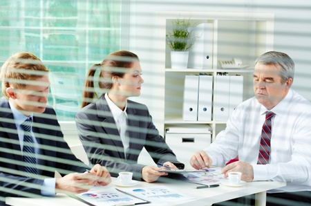 Portrait of busy people discussing new working plan at meeting in office Stock Photo - 12873140