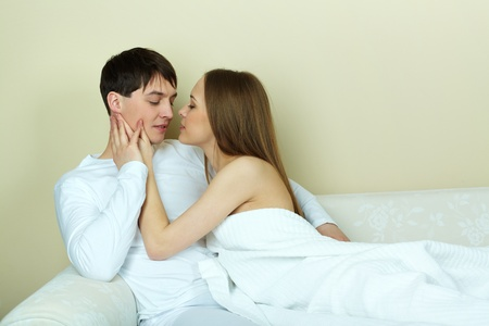 passionate lovers: Pretty female and her husband looking passionately at one another Stock Photo