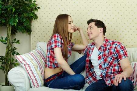 human relations: Happy couple in casual clothes having rest at home