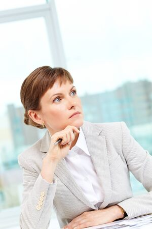 Portrait of pensive businesswoman planning work in office  Stock Photo - 12873093