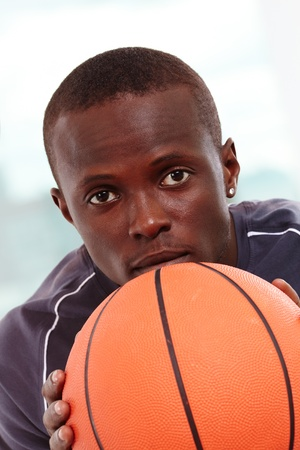 Image of a basketball player with ball looking forward photo