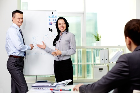 Confident business partners carrying out presentation of business plan to manager Stock Photo - 12873004