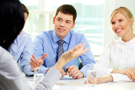 Positive business people listening attentively to their leader Stock Photo - 12872983
