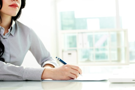 one to one meeting: Business woman taking notes at seminar