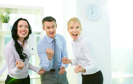 Business people looking at camera and expressing their success Stock Photo - 12873073