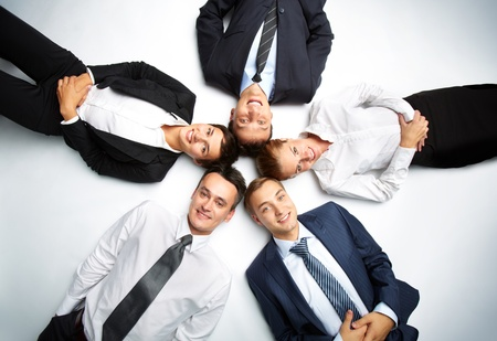 teamwork together: Five business people looking at camera and smiling Stock Photo