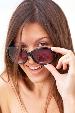 Portrait of pretty young lady looking at camera through sunglasses Stock Photo - 12964026