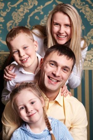 Cheerful family looking at camera Stock Photo - 13037667