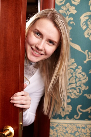 peeping: Portrait of happy woman with long blond hair