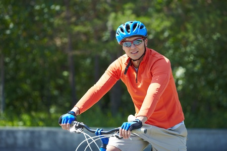 Portrait of a handsome man riding a bike Stock Photo - 13036921