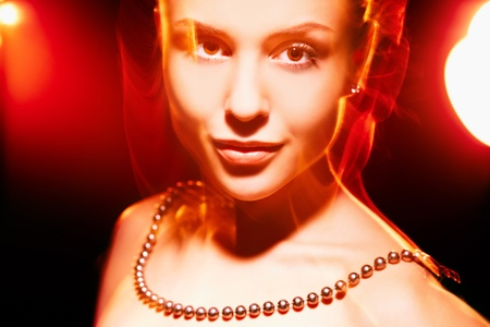 Face of pretty girl looking at camera in neon lights Stock Photo - 13036771