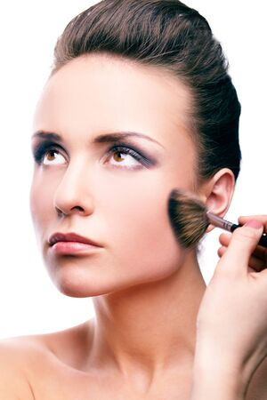 Image of gorgeous woman applying rouge on her cheek Stock Photo - 13037169