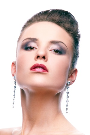 Gorgeous woman with long earrings looking at camera photo