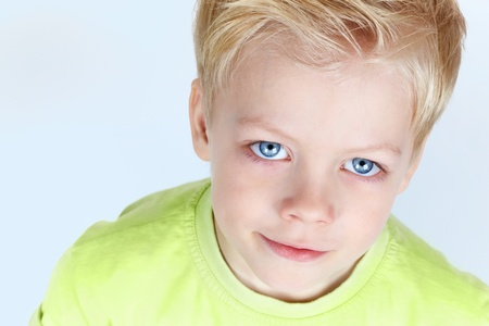 Close-up portrait of a charming blue-eyed boy photo