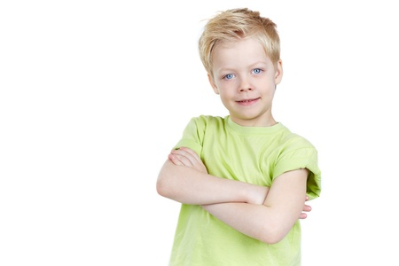 Portrait of a cute little boy posing for camera isolated on white background, copyspace provided photo