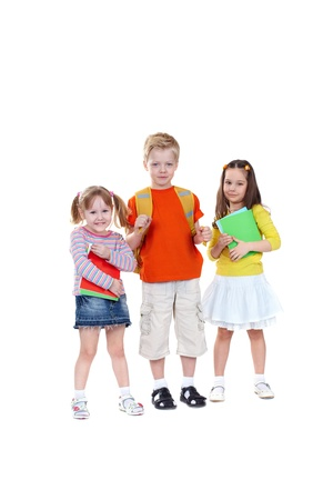 Three school children isolated on white background looking confidently at camera Stock Photo - 13035352