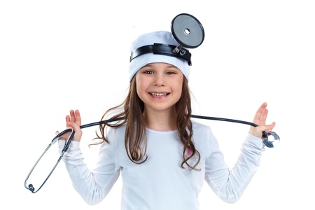 jolie petite fille: Cute petite fille habill� comme un m�decin regardant la cam�ra avec un sourire joyeux