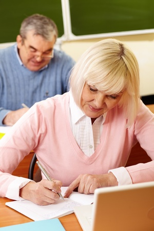old writing: Vertical shot of a senior couple studying diligently Stock Photo
