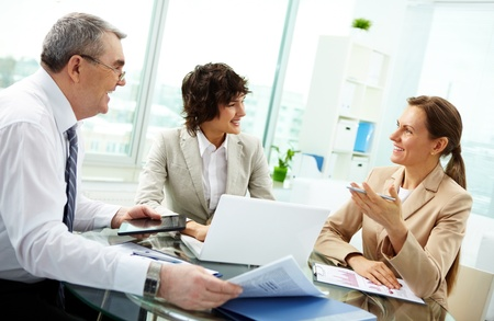 Female leader talking to her workgroup about a new profitable idea  photo