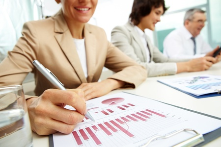 corporate meeting: Female business lady carrying out the business data analysis