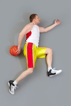Basketball player jumping high being ready to throw the ball into basket photo