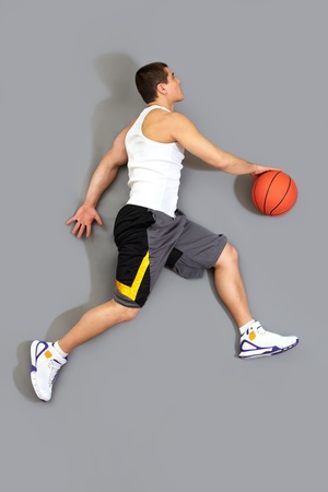 Guy dribbling the ball ready to throw it in the basket, the above view photo