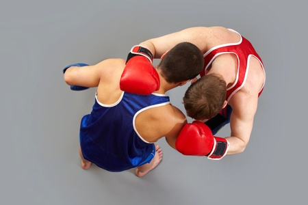 Boxing fighters holding each other in a hack photo