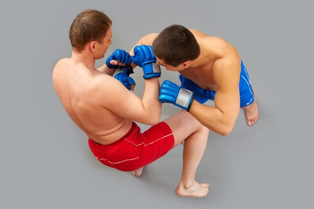 Sparring of two muscular man fighting vigorously photo
