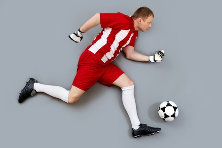 dynamic activity: Determined soccer player dribbling the ball to score a goal Stock Photo