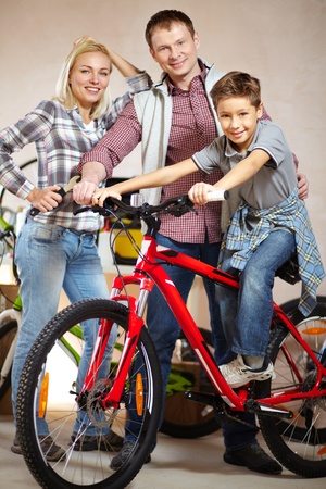 Portrait of happy family with bicycle looking at camera Stock Photo - 13119197