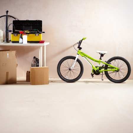 Image of mountain bike and some equipment in garage photo