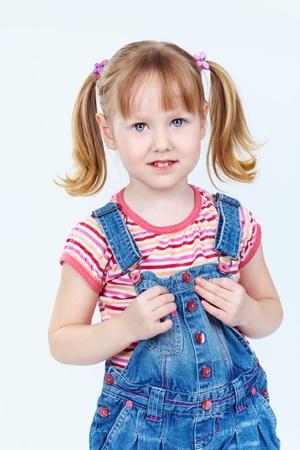 jumpsuit: Vertical portrait of a sweet girl in a denim jumpsuit