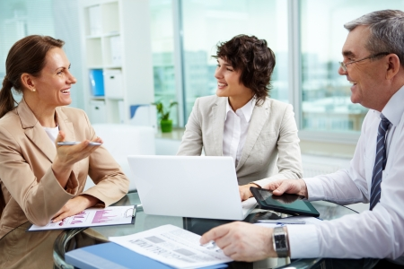 friendly people: Female leader talking to her workgroup about a new profitable idea