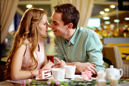 A young happy woman and her boyfriend close to one another Stock Photo - 13119075