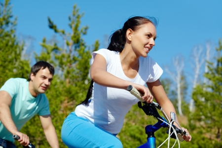 summer sport: A young couple racing on bicycles  Stock Photo