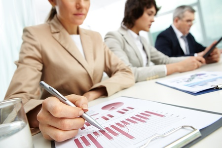 Female business lady carrying out the business data analysis photo