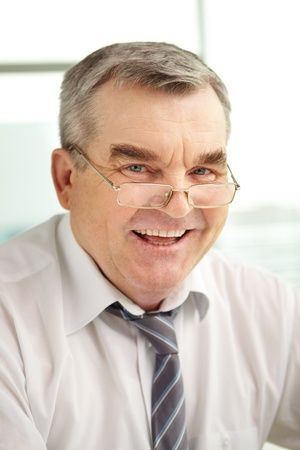 Mature businessman in eyeglasses looking at camera Stock Photo - 13198679
