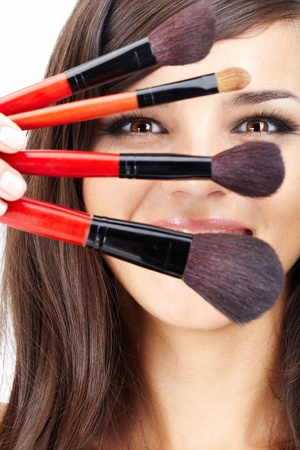 bristle: Close-up of cosmetic brushes with female face behind Stock Photo