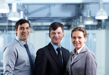 Portrait of a confident business team looking at camera and smiling photo