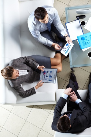 Overview of business team discussing some graphs and diagrams Stock Photo - 13198847