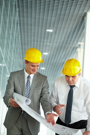 Two architects discussing new project at meeting Stock Photo - 13198868