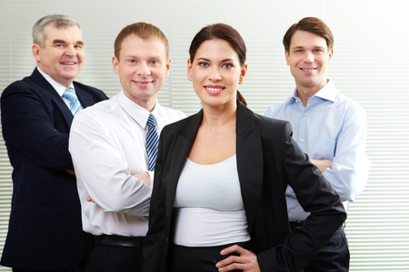 A business team of four looking at camera and smiling Stock Photo - 13198842
