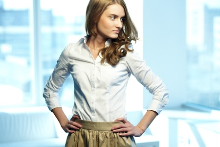 Image of gorgeous woman in smart casual looking aside photo