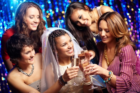 Tilt up shot of friends drinking champagne to the bride�s health, bridal party Stock Photo - 13302142
