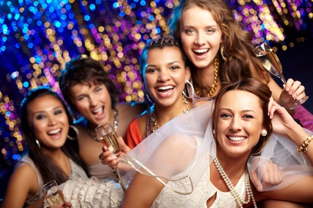 Group shot of young women celebrating their friend's forthcoming marriage, hen party photo