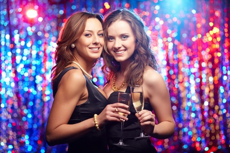 Young women smiling at camera enjoying themselves at club