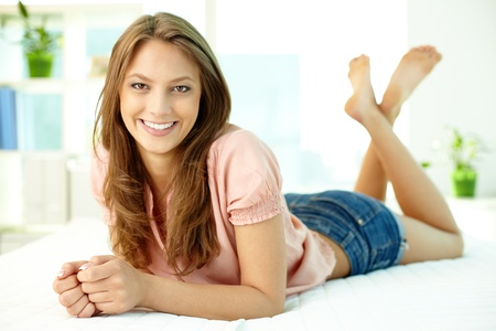 Smiling beauty resting at home looking at camera with a smile Stock Photo - 13313491