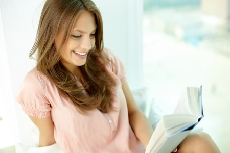 absorbed: Girl being totally absorbed in an interesting book Stock Photo
