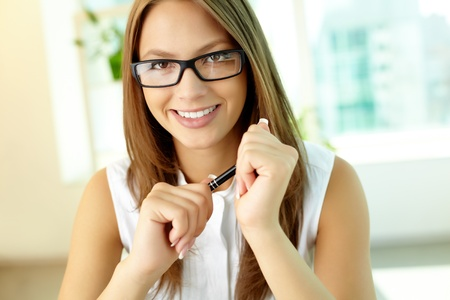 occupying: Close-up of a cheerful young woman occupying a leading position in the company Stock Photo