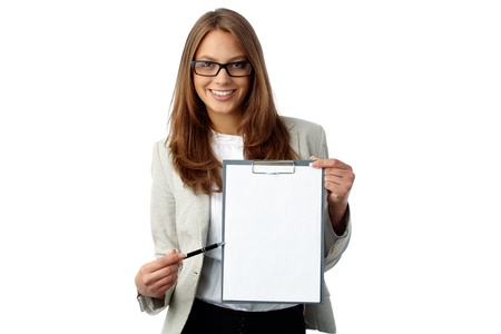 Business woman holding a blank document pointing where to put signature photo